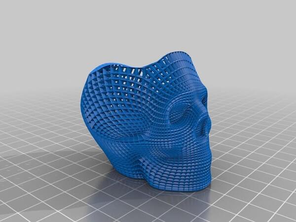 screenshot da tela do fatiador para impressora 3d caveira azul em cima de um plano infinito